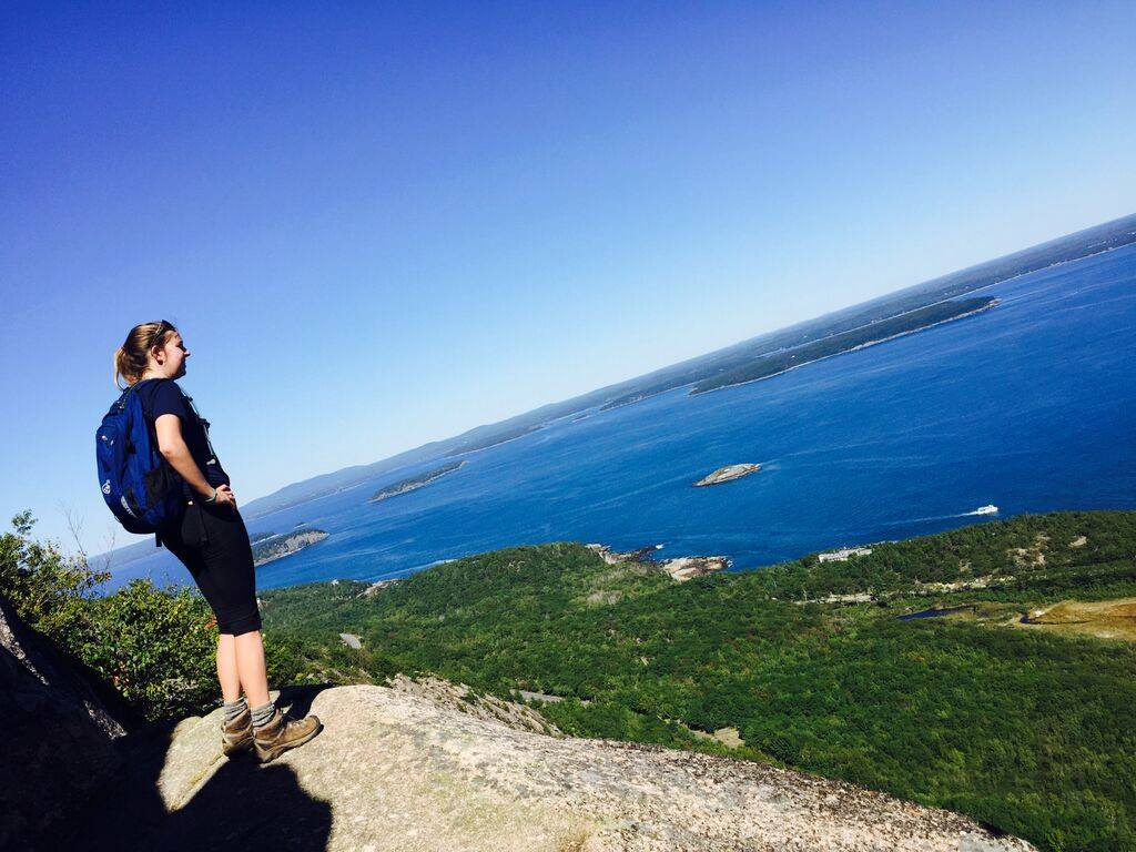 Riley overlooks Acadia's beauty from the Precipice Trail