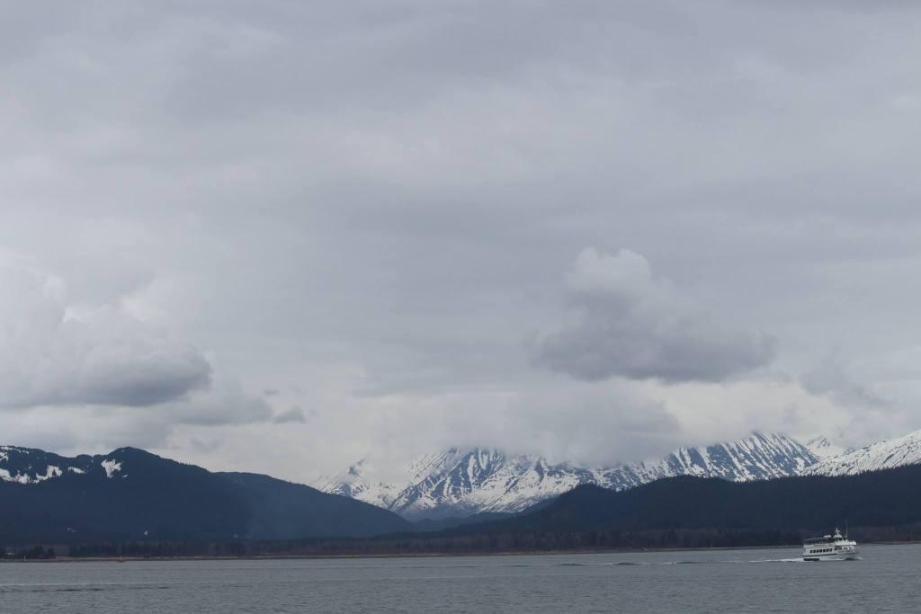 A tour boat sails through Kenai Fjords National Park