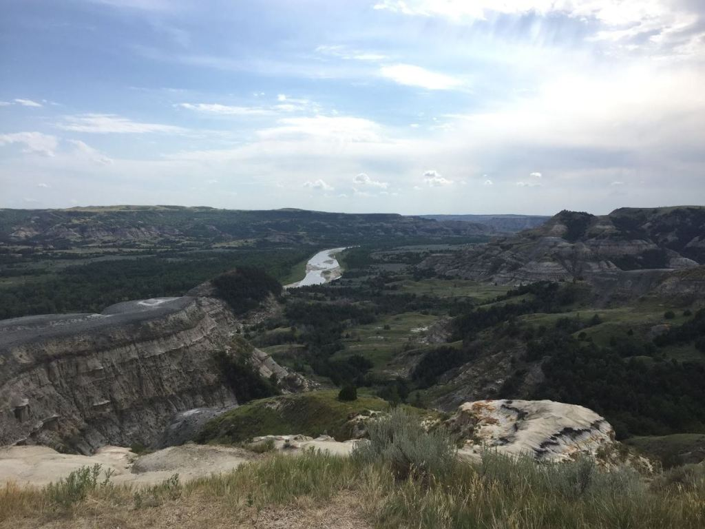 Theodore Roosevelt National Park's north unit featuring views of badlands and a winding river