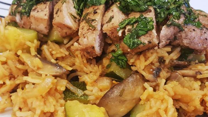 Herbed Pork Steak with Tomato Veggie Rice and Parsley Drizzle