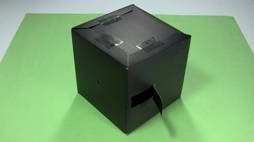 small resolution of the black poster board pinhole camera sitting on a table