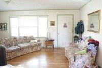 living room, facing front door | Rina Marie