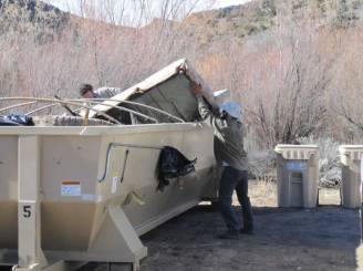 11. The historic Buckman site along the Rio Grande had become a literal dump. Mattresses, beds, sofas, tires, diapers, and thousands of beer cans and bottles were dumped throughout the area. For the second clean-up day Santa Fe County brought out a dumpster and several recycling bins to help make the process easier for the volunteers.