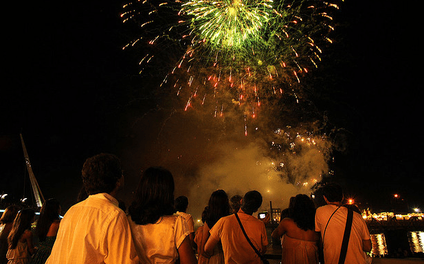 Watching fireworks dressed in white for New Year's Eve, Rio de Janeiro, Brazil News
