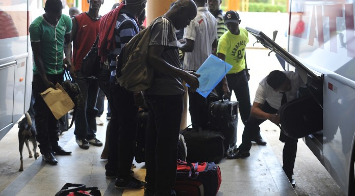 Haitian immigrants in the Northern state of Acre, boarding bus to Southeastern Brazil,