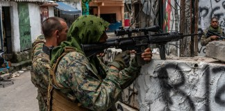 Member's of Rio's BOPE special operations unit conduct an operation against drug traffickers in Penha, the north zone of Rio de Janeiro. (Photo: C.H. Gardiner)