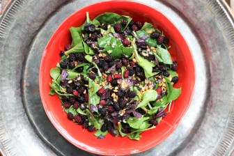 Mulberries on a fresh farmer's market bok choy salad.