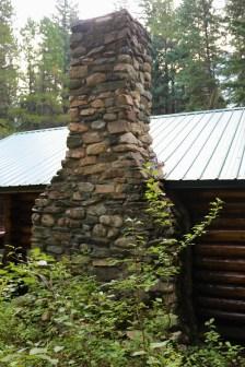 The cabin's boulder chimney