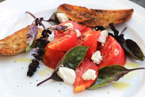 Heirloom tomatoes, fresh Mozzarella, and red basil with crostini