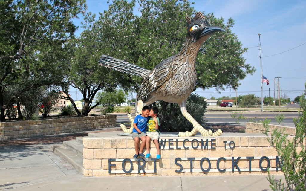 Best Places to stop on a Southwest Road Trip|Two kids in front of giant bird statue in Fort Stockton Texas