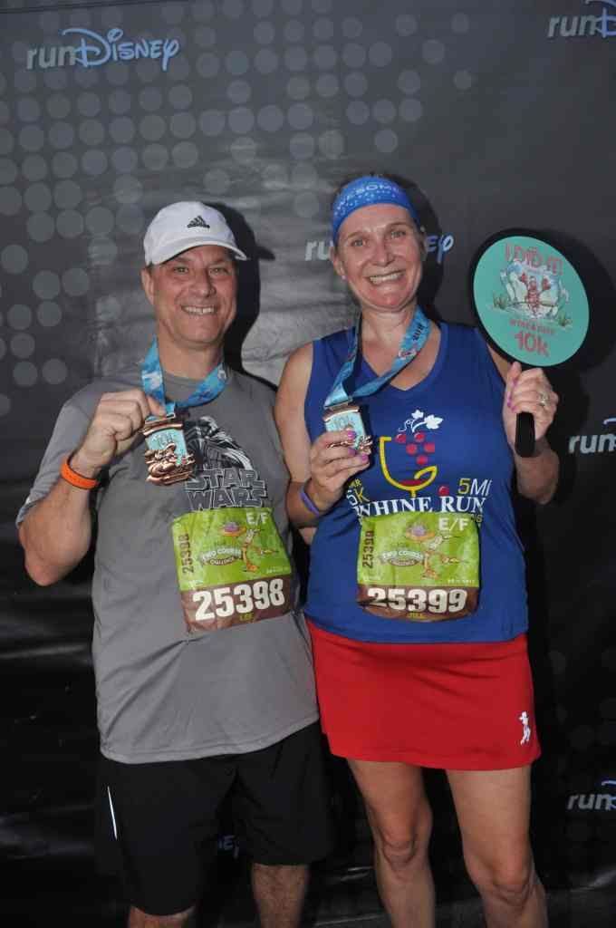 Disney Wine and Dine Half Marathon Weekend - Your Questions Answered|Run Disney Ripped Jeans and Bifocals Man and woman in running clothes with finisher medals