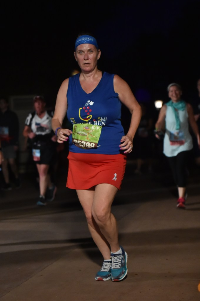 Disney Wine and Dine Half Marathon Weekend - Your Questions Answered|Run Disney Ripped Jeans and Bifocals Woman in red skirt and blue shirt running