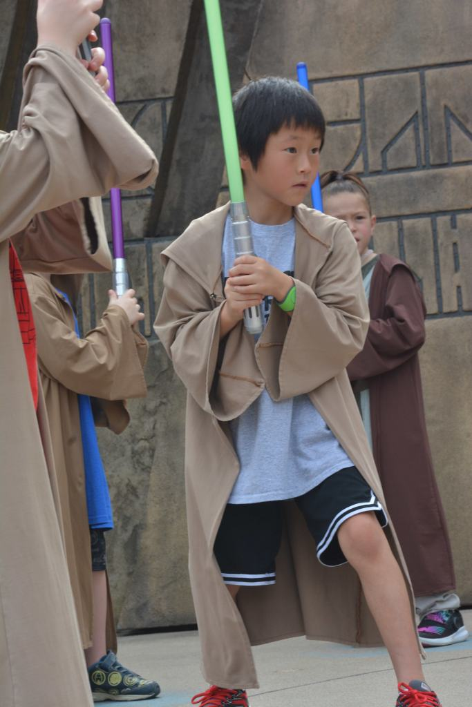 The Jedi Training Academy at Disney's Hollywood Studios: What you need to know|Little boy with a light saber at Disney world