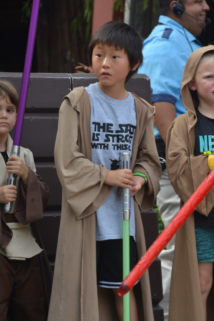 The Jedi Training Academy at Disney's Hollywood Studios: What you need to know|Young boy with light saber in jedi robe