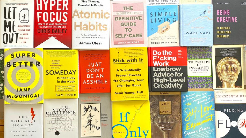 collection of covers of self-help books