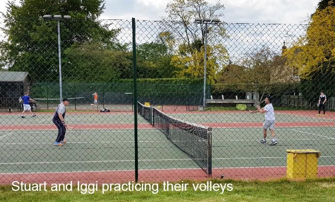 Stuart and Iggi practicing volleys