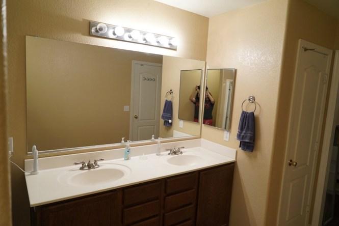 DIY bathroom mirror frame before