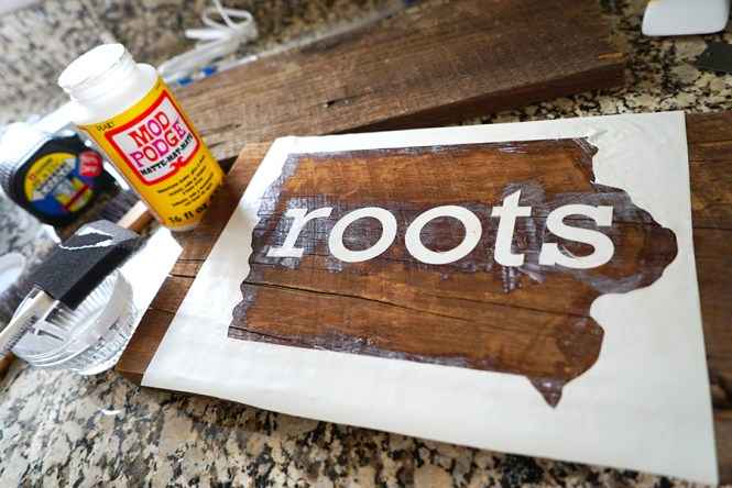 Mod Podge on the Sign - DIY Reclaimed Wood Sign