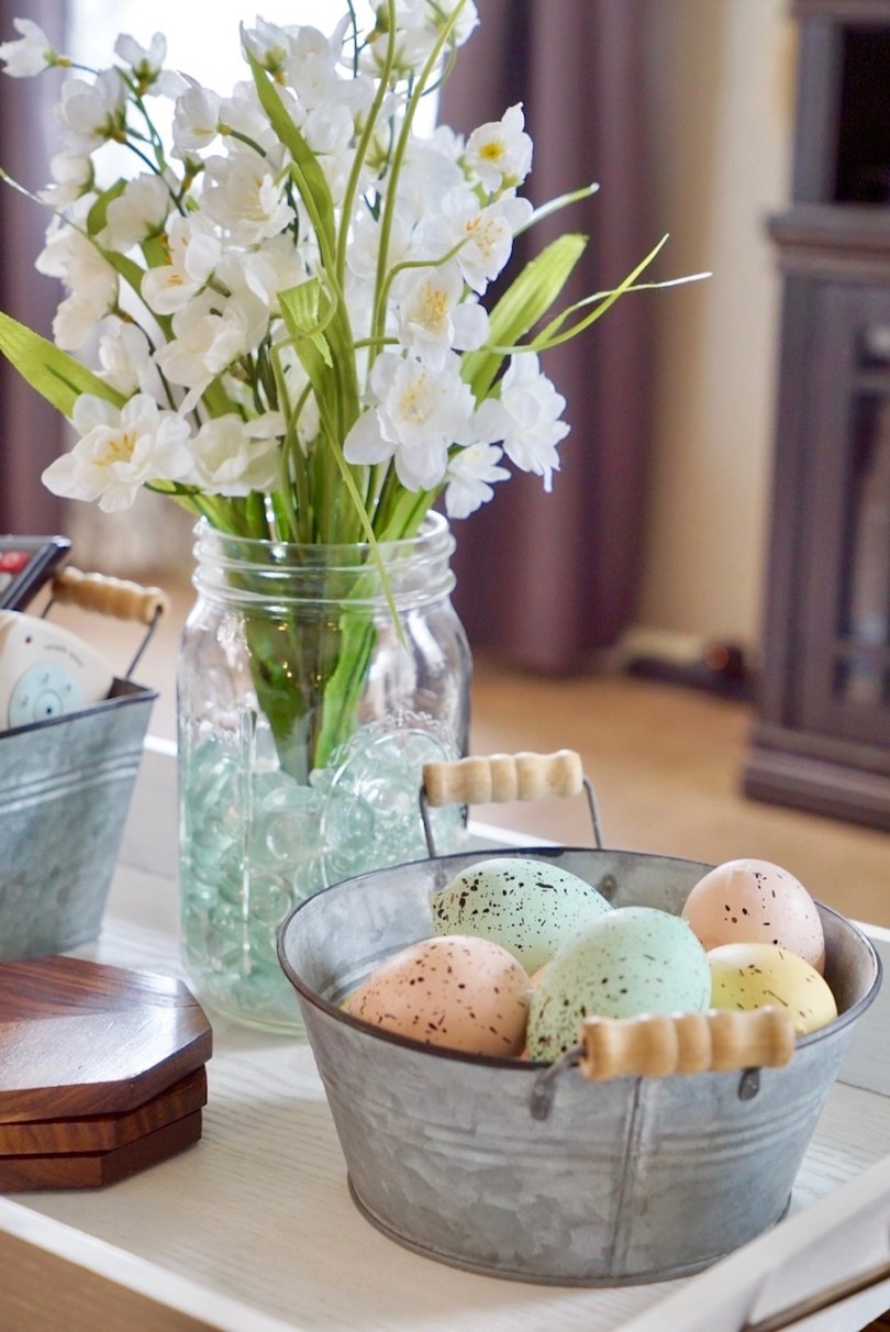 spring decor ideas - tin with pastel eggs and flowers