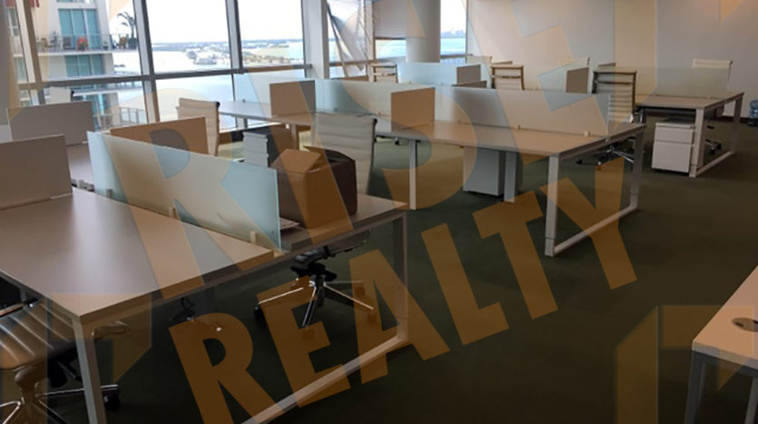 1111 Brickell Avenue office bullpen desks with ocean view floor-to-ceiling windows