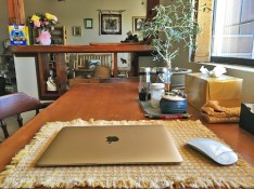 The laptop on my small kitchen table ... office