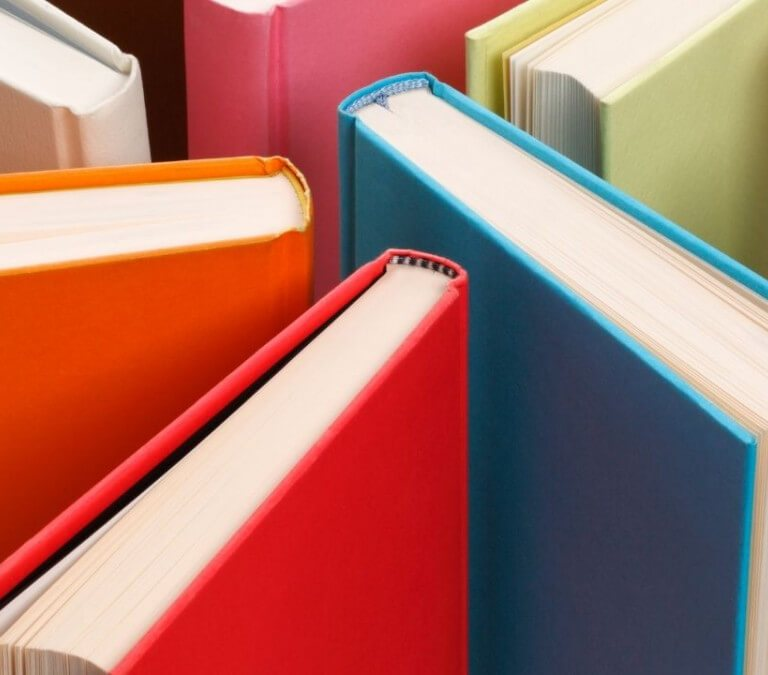 12 COLORFUL BOOK COVER DESIGNS ON MY BOOKSHELF. Looking at some of the more colorful books on my shelf. Text © Rissi JC