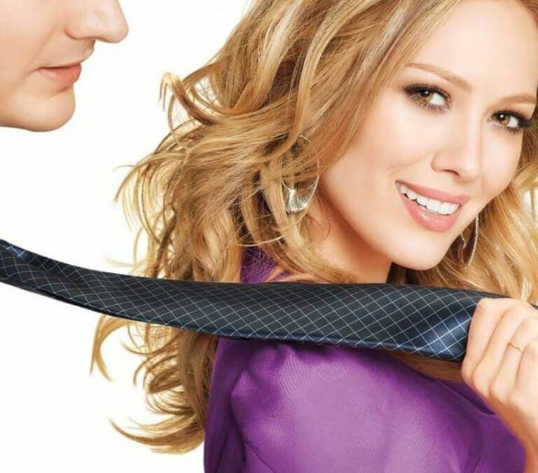 """'BEAUTY & THE BRIEFCASE': HILARY DUFF IN A FUN MISTAKEN IDENTITY ROMCOM. An ABC Family rom-com about a woman who goes """"undercover"""" to find a date. © Rissi JC"""