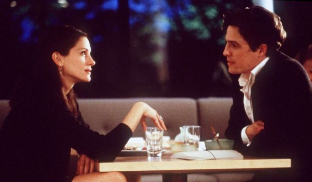 'NOTTING HILL': ONE AMERICAN CHARACTER IN A BRITISH ROMANCE. Julia Roberts plays Anna, an actress looking to escape the spotlight. Hugh Grant co-stars. © Rissi JC