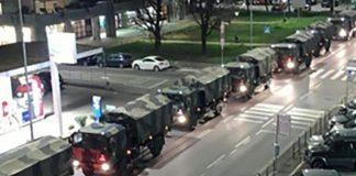 L'immagine dei mezzi militari, a Bergamo, che trasportano le bare verso i forni crematori