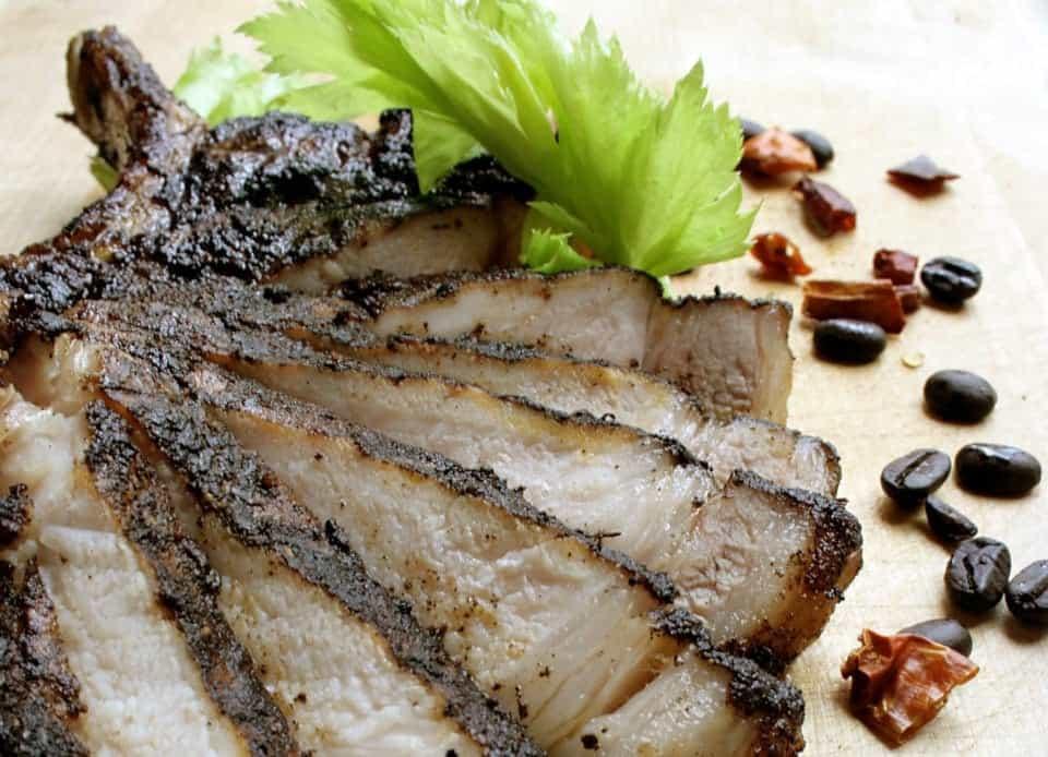 sliced pork chop arranged on a platter