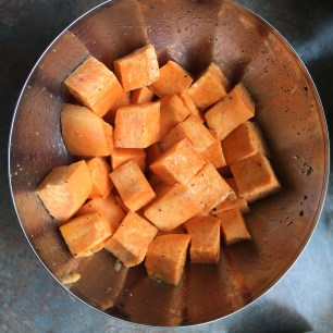 Sweet potatoes coated with olive oil and seasoned with salt and pepper