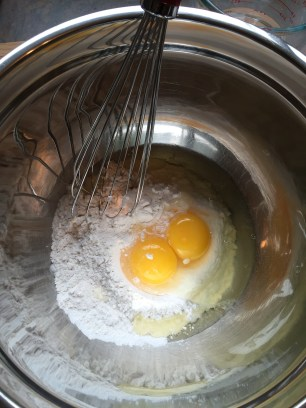 Mixing flour, baking powder and eggs