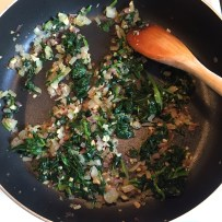 Sautéing onion with spinach