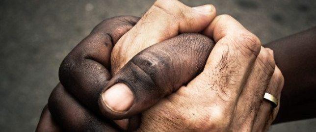 Two hands shakes. Tribute to Mandela. Tanzania.