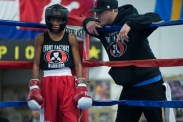 Coach TJ gives Cory advice before a boxing match against Andre Mendez.