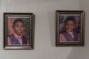 Nunu, right, and his brother Joma, left, are shown in printed portraits displayed on the walls of their home in Batavia, N.Y., Dec. 11, 2016. Nunu convinced his brother Joma to where pink on the day of their family photo shoot said Mrs. Schmieder.