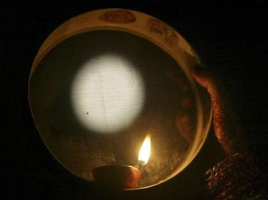 A ritual of this festival - looking at moon from sieve