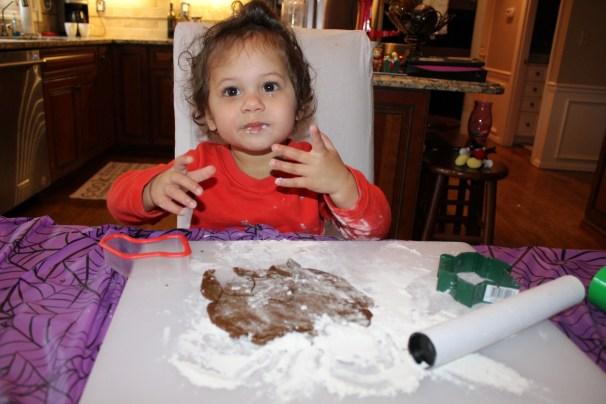 Toddler eating gingerbread