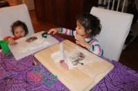 Children cutting out gingerbread