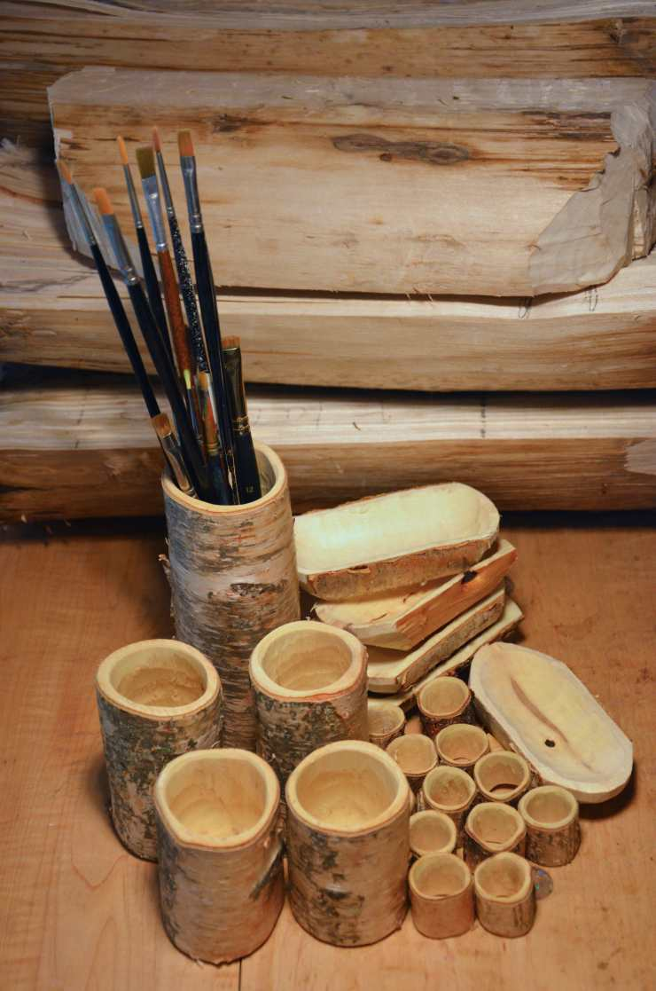 An assortment of napkin rings, condiment dishes, and hollowed boxes, hand-crafted from sustainably-harvested birch.