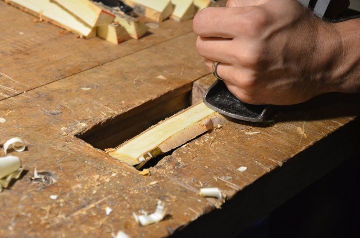 Hand-planing birch, using the integrated wagon-vise on a custom workbench.