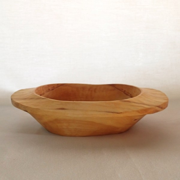 A hand-carved poplar dinner bowl, sustainably harvested from RivenJoiner.com.