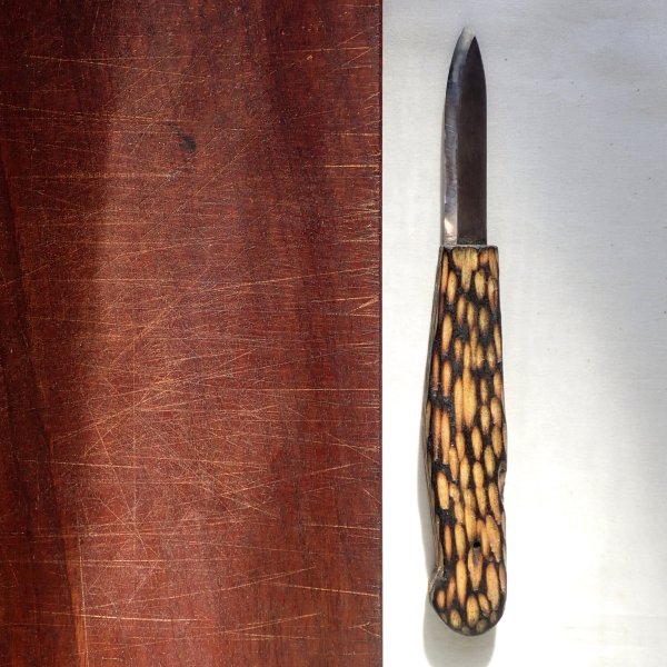 Seven-inch paring knife with hand-forged blade and hand-carved birch handle, blackened, with gouge detail, at RivenJoiner.com.