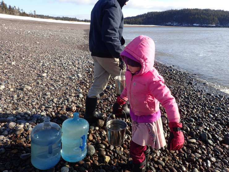 Just gathering a little sea water to make sea salt! RivenJoiner.com at Jasper Beach, Machiasport, ME