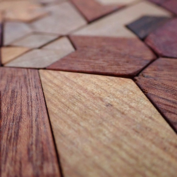A close-up of a wooden puzzle, hand-carved by Spencer Michalski at RivenJoiner.com.