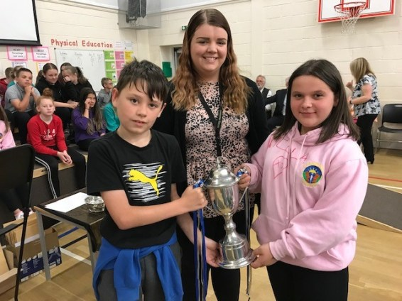 The House Cup is, officially, handed over to the Hayton House Captains by Mrs Robb!