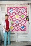 SUGAR CANDY! pieced by Sharon Lee of Terre Haute and quilted by Valerie Funk