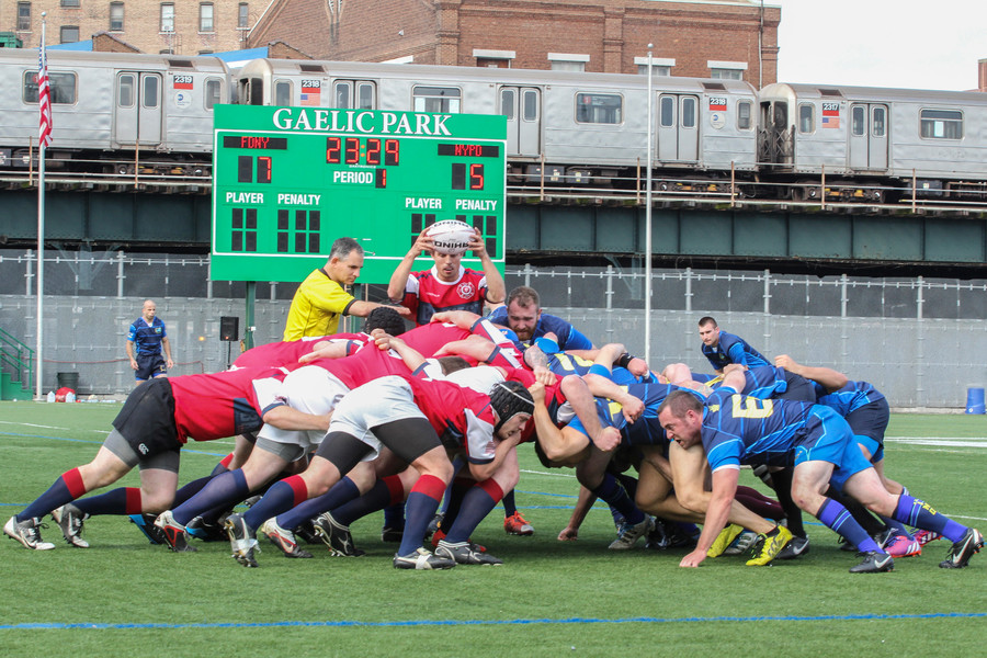 The NYPD Rugby Football Club defeats the FDNY Rugby Football Club 20-14 on Saturday. Funds raised at the game will go to the family  of Det. Joseph Lemm, who was killed while serving in the Air National Guard in Afganistan on Dec. 11.