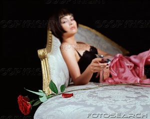 woman-with-cocktail-glass-and-rose-is611-0194