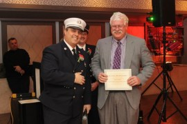 Capt. Baycan Fideli and firefighter David White (163 calls).